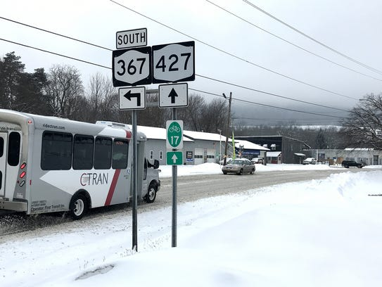 Vehicles drive on snow-covered streets Wednesday afternoon