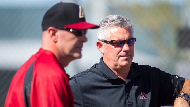 A season that looked bright for Kirk Gibson (left) and Kevin Towers in spring training has been derailed by a series of injuries.