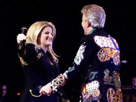 Trisha Yearwood is welcomed by Porter Wagoner on the