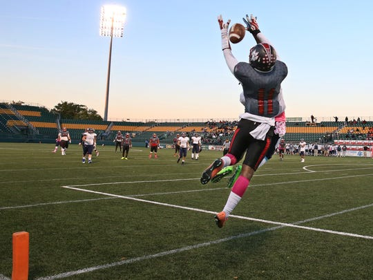 Wilson's Jervon Johnson, 11, goes up for a pass in the end zone but can't haul it in, as Eastridge's Shalamar Curry defends.