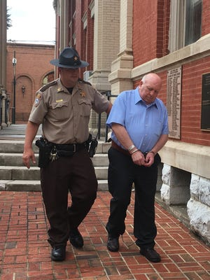 David Vatter, 69, charged with first-degree murder in the 2014 death of his wife, is led away from the Augusta County Courthouse on Monday following the first day of his scheduled four-day trial.