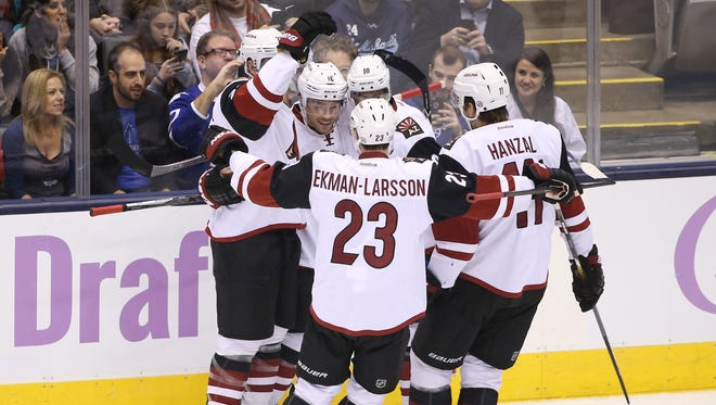 Oct 26, 2015: Arizona Coyotes center Max Domi (16) celebrates his power-play goal in the first period with teammates against the Toronto Maple Leafs at Air Canada Centre.