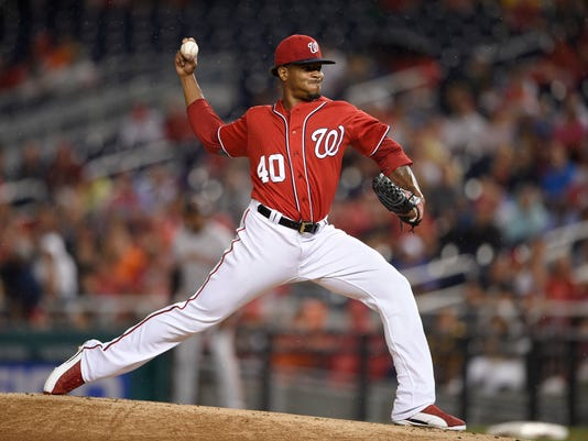 Washington Nationals starting pitcher Edwin Jackson delivers a pitch during the first inning of a baseball game against the San Francisco Giants, Saturday, Aug. 12, 2017, in Washington. (AP Photo/Nick Wass)