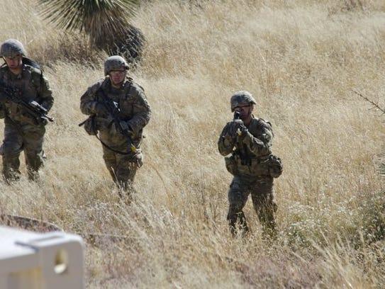 Solders shoot while pushing toward Mountain Village