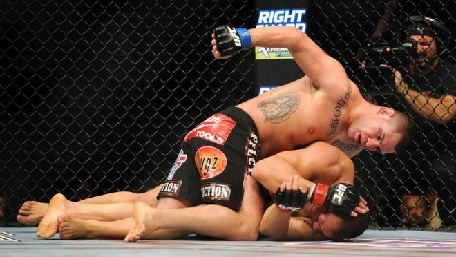 Cain Velasquez pounds Junior dos Santos during a UFC heavyweight title bout Dec. 29, 2012. Velasquez won.