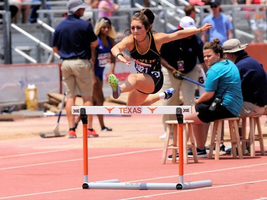 Wylie's Madi Latham jumps the first hurdle during the Class 4A girls 300-meter hurdles at the UIL State Track and Field Championships at the University of Texas' Mike A. Myers Stadium in Austin on Saturday, May 12, 2018. Latham finished fifth with a time of 45.77.
