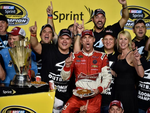 Kevin Harvick, center, celebrates with his wife DeLana,