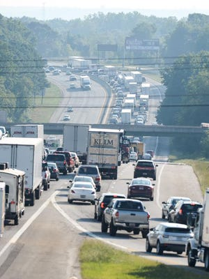 Traffic has been backed up on Interstate 85 northbound after money flew out of an armored truck Monday morning, authorities said.
