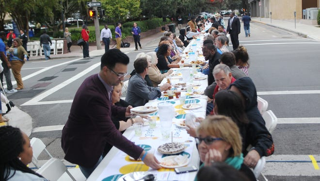 Residents gathered Sunday over food and shared conversation across a single row of tables that spanned nearly the lengths of two city parks. It was the city and county's The Longest Table event intended to bring residents together to discuss--and solve--issues affecting the community.