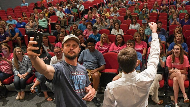 Supporters of Lisa Houston cheer for her, while the Anderson One School Board is in a closed session, during a special meeting at the Palmetto High School auditorium on Wednesday.