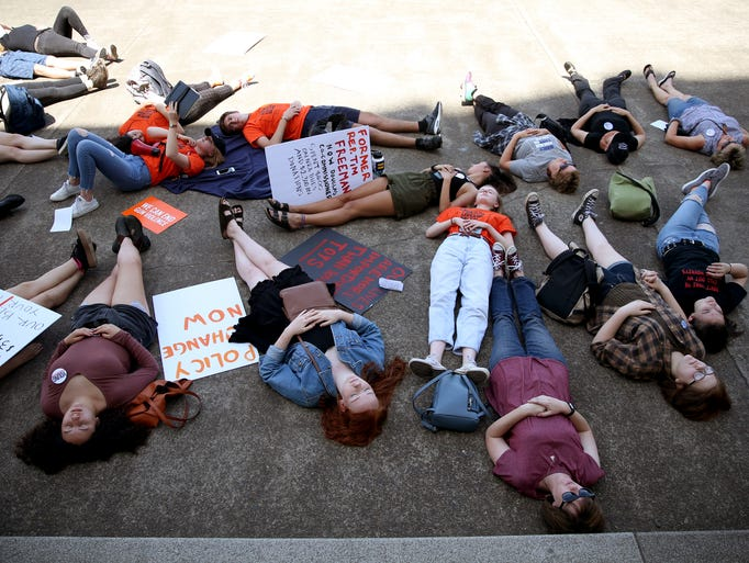 More than 30 people stage a die-in on the two-year