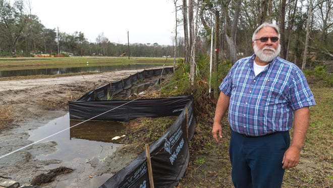 Scott Boutwell stands in the backyard of his property to show flooding issues in a February 2018 issue of The Record. Now Boutwell has filed to run for St. Johns County Sheriff as a write-in candidate, closing the primary to Republicans only.
