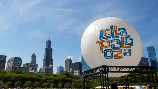 A balloon welcomes festgoers to Lollapalooza in Chicago's Grant Park on Aug. 4, 2013.