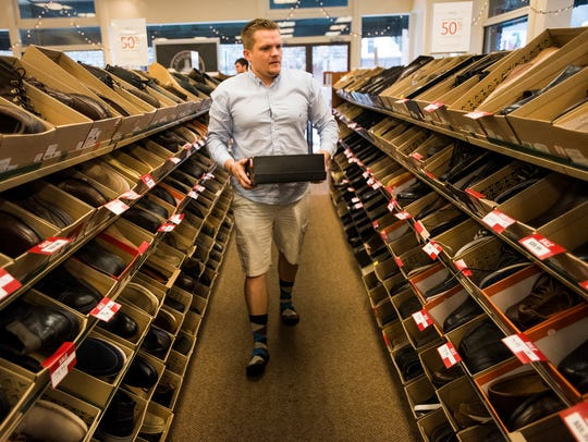 Danny McKenzie, of Hanover, browses men's shoes for
