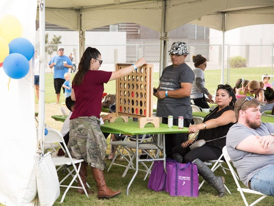 A friendly game of Connect Four is played during the 2016 Phoenix Pizza Festival.
