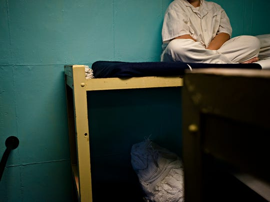 An inmate sits on her bed at Tutwiler Women's Correction Facility in Wetumpka, Ala., on Monday, Feb. 6, 2017. Tutwiler is Alabama's second oldest corrections facility.