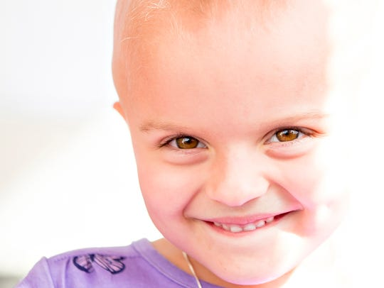 Lilly Stack, 5, smiles on Monday, Feb. 21, 2017, at