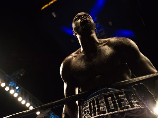 Deontay Wilder looks out at the crowd after knocking down Gerald Washington during the WBC heavyweight title boxing bout Saturday, Feb. 25, 2017, in Birmingham, Ala. Wilder defeated Washington in the 5th round with a TKO. (AP Photo/Albert Cesare)