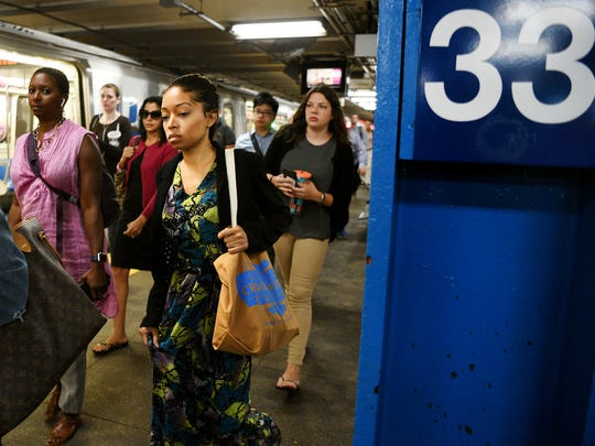 Additional commuters funnel through the 33rd Street PATH station in Manhattan, after being rerouted through Hoboken due to the beginning of repairs at New York Penn Station.