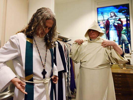Strand and the Rev. Robert L. Shearer prepare for services