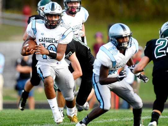 Lansing Catholic's Michael Lynn III runs for a touchdown