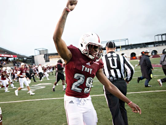 Troy linebacker Tron Folsom (29) celebrates after the NCAA football game between Troy and Georgia Southern on Saturday, Oct. 28, 2017, in Troy, Ala. Troy defeated Georgia Southern 38-16.