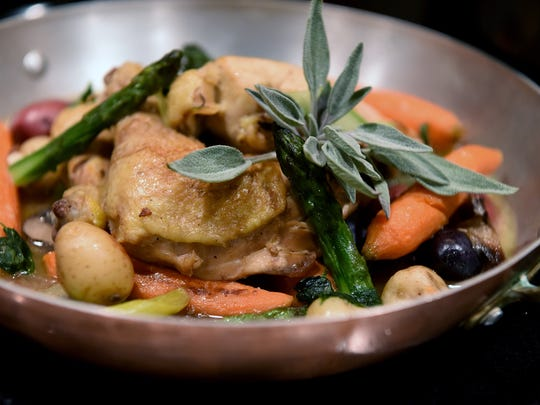 Chicken pot au feu Barbara James cooked with Chef Michael Latour at James' Clifton home on Tuesday, November 14, 2017.