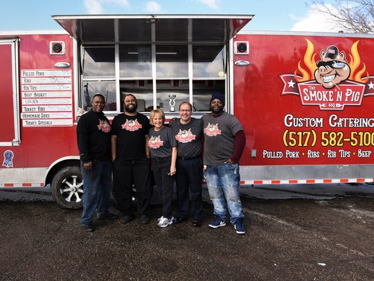 The Smoke 'N Pig BBQ crew, pictured, Tuesday, March