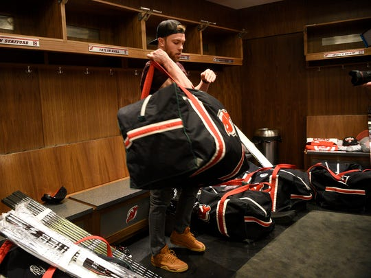 New Jersey Devils forward Taylor Hall clears out his locker at the Prudential Center in Newark on Tuesday, April 24, 2018.