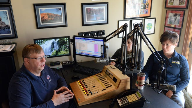 WLOH's co-owner and operations manager, Mark Bohach, left; show host Tina Thompson, center; and news director and show host Anne Darling talk about the station's format change Wednesday in Lancaster. WLOH will switch from a talk radio format to country music Friday.