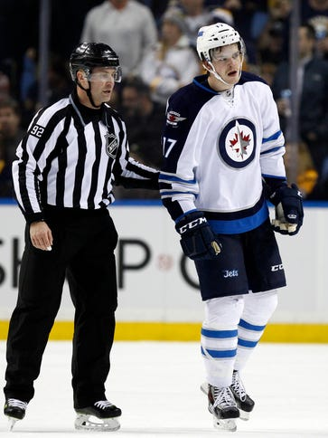 Winnipeg Jets left wing Adam Lowry (17) gets a game