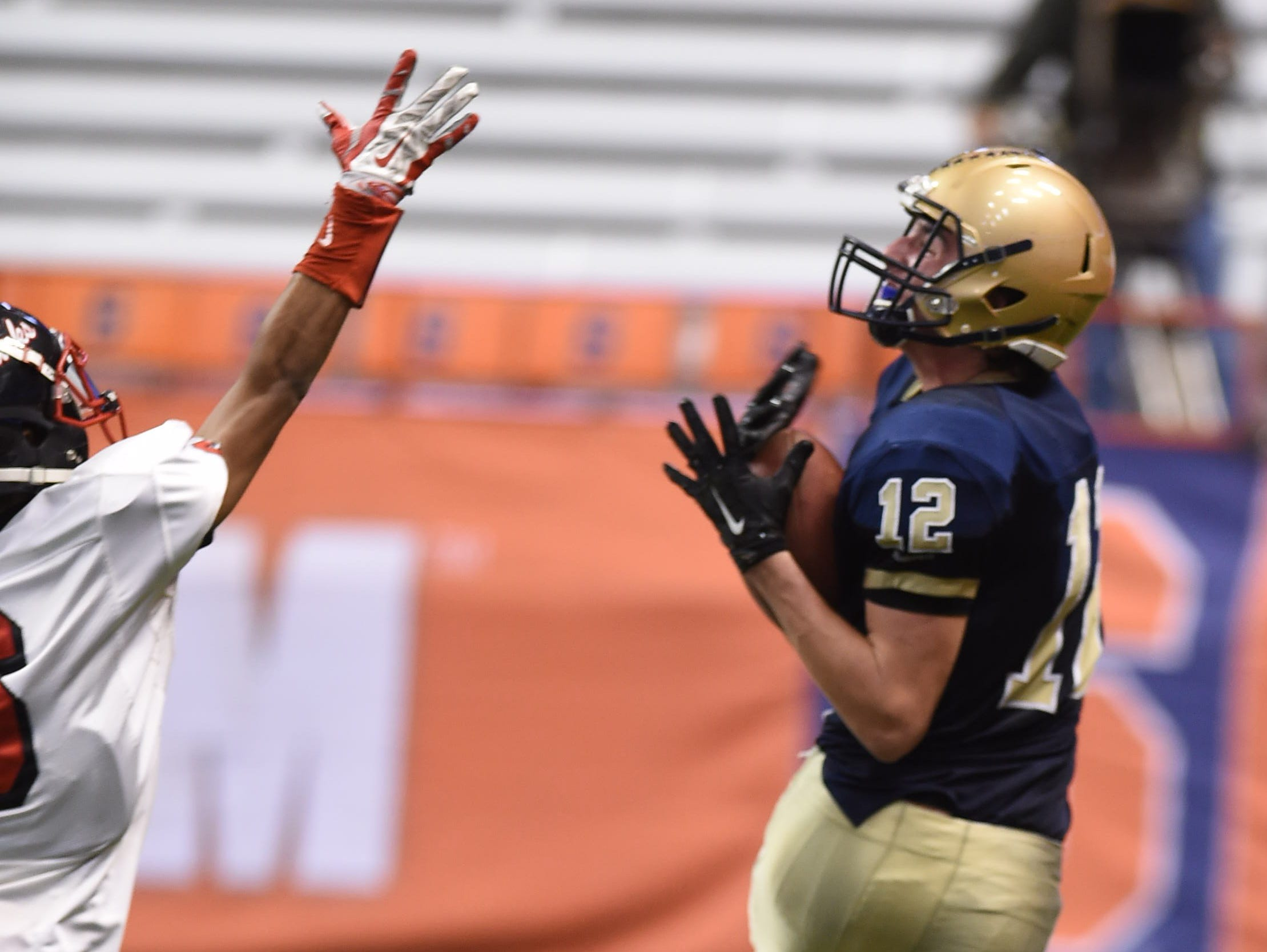 Lourdes' Luke Timm catches the ball during the New York State Championship final versus South Park in Syracuse on Friday.