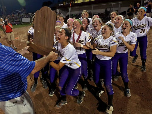 Johnston players run to collect their trophy after 10- 2 win over Southeast Polk in Class 5-A championship game at the 2014 Girls State Softball Tournament in Ft. Dodge on Friday July 25, 2014.