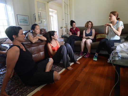 Filmmaker Josephine Decker, right, of Brooklyn, N.Y., gives a group of dancers instructions before rehearsing interpretive dance as a part of her film on Thursday, July 9, 2015. Several filmmakers were in Cape Charles, Va. for the week-long Experimental Film Virginia.