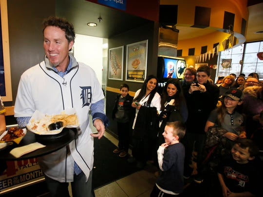 Joe Nathan acts as a celebrity server at the Buffalo Wilds Wings in Rochester Hills during an event for the Detroit Tigers Winter Caravan on Jan.22, 2015.