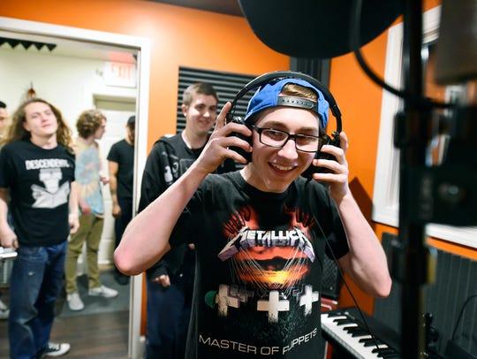 Hanover sophomore Nash Miller tries on headphones in
