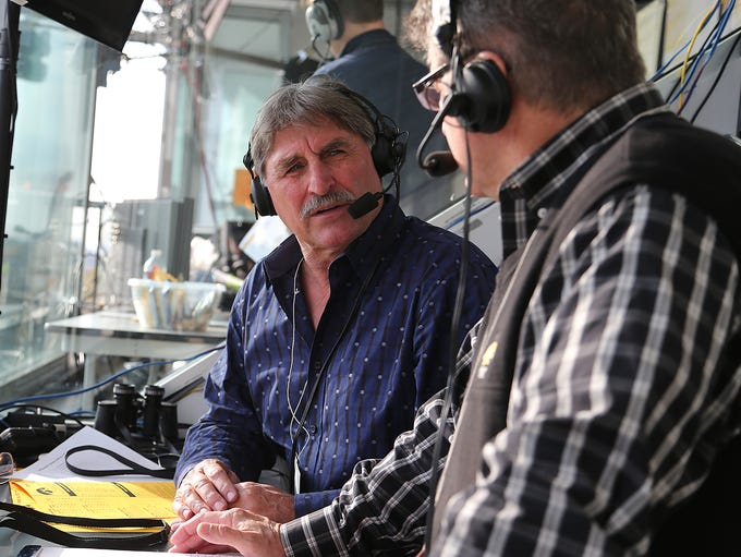 Ed Podolak, left, talks with Iowa play-by-play announcer