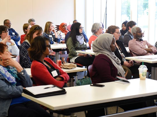 People gathered to listen to Fartun Weli, founder & executive director of ISUROON, Minneapolis, talks about female genital cutting Friday, May 19, at the St. Cloud Public Library.  The issue has caused concern with health care professionals and legislators.