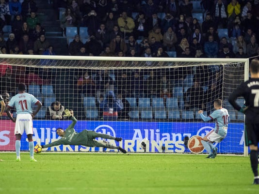 Real Madrid's goalkeeper Keylor Navas navas stops the penalty from RC Celta's Iago Aspas during a Spanish La Liga soccer match between RC Celta and Real Madrid at the Balaidos stadium in Vigo, Spain, Sunday, Jan. 7, 2018. (AP Photo/Lalo R. Villar)