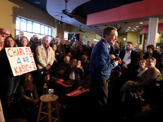 John Kasich takes questions from the crowd during the Charleston County Town Hall at Finn's Brick Oven in Mt Pleasant, South Carolina, Wednesday February 10, 2016.