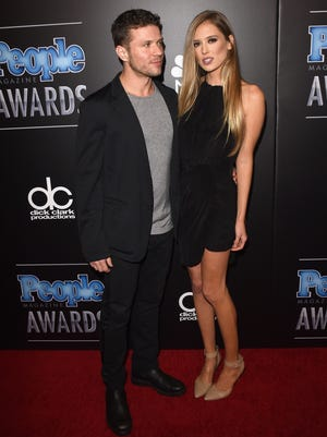 Actor Ryan Phillippe and actress Paulina Slagter attend the People Magazine Awards at the Beverly Hilton Hotel on Dec. 18, 2014, in Beverly Hills, California.
