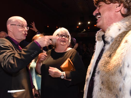 Outgoing Executive Director John Killacky, from left, and Linda Terrasi of South Burlington share their delight with the Sonny Bono-dressed Eric Flegenheimer, chairman of the Flynn board, at the at a celebration honoring Killacky.