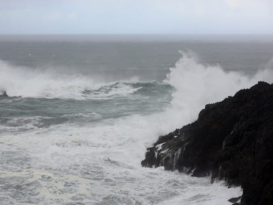 Waves crash against the rocks at Cape Foulweather near Depoe Bay on  a story day at the coast. Wednesday, Oct. 15, 2014.
