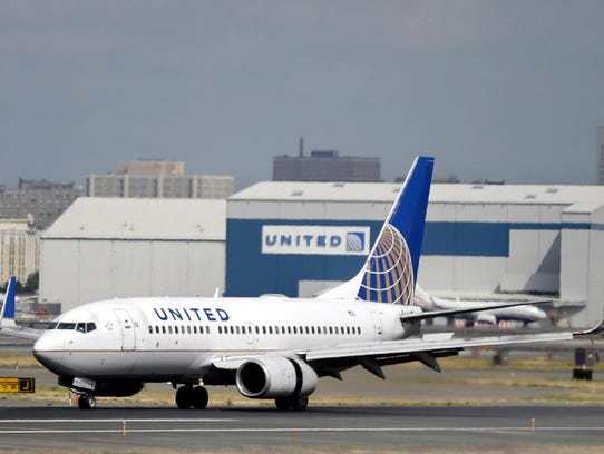 A United Airlines passenger plane lands at Newark Liberty