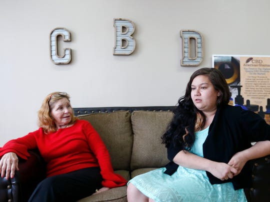 Sharon Wilkinson (left), a sales representative for American Shaman, and Natalie Christianson, the daughter of the owners of CBD of Springfield, talk about the healing powers CBD oil, an oil derived from the hemp plant, on Wednesday, Feb. 28, 2018.