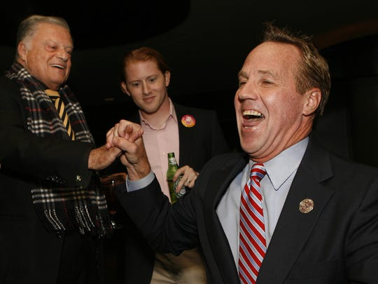 Former Palm Springs Mayor Steve Pougnet (right) high fives Harold Matzner, chairman of the Palm Springs International Film Festival, on election night in 2011.
