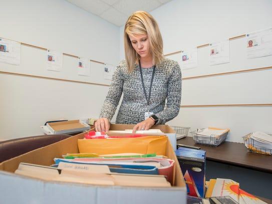 Mitigation specialist Lindsey Johnson goes through