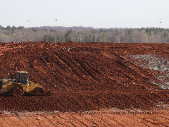 Dirt is put over garbage at Bi-County Solid Waste Management.