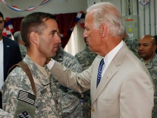 U.S. Vice President Joe Biden, right, talks with his