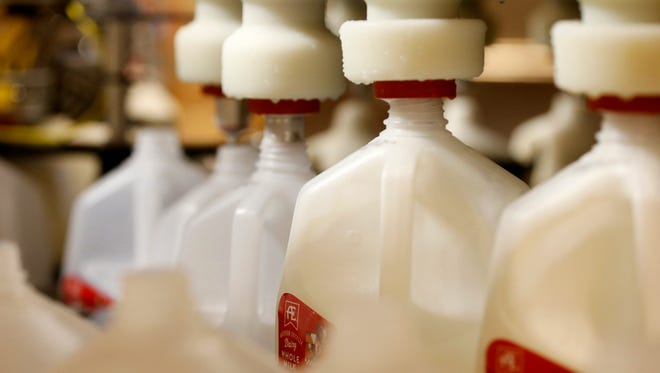 Bottles of whole milk are filled at the Anderson Erickson milk plant in Des Moines.